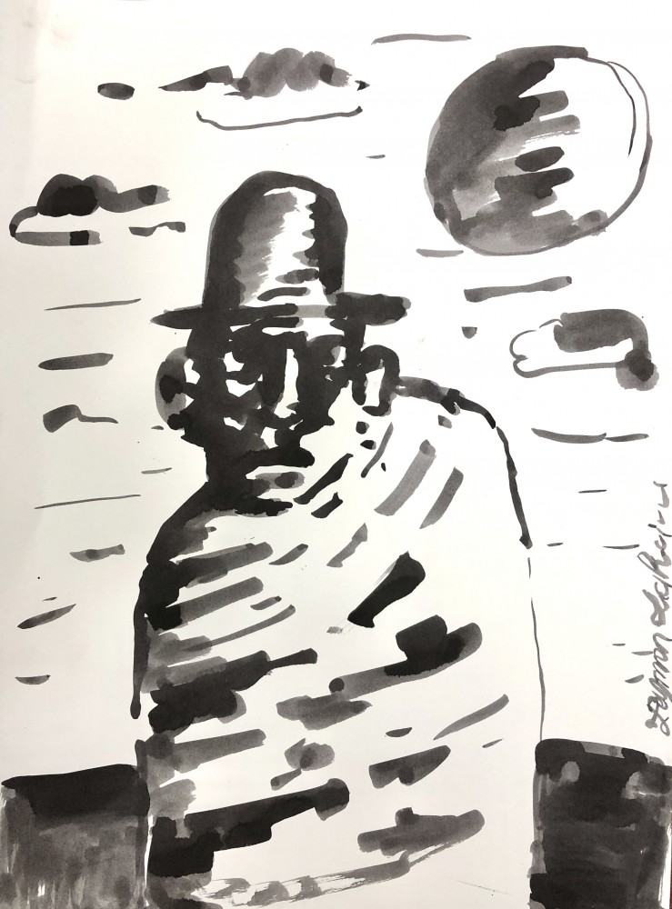 man with hat and poncho